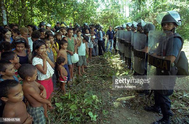 CONTENT] Members of Brazil's Landless Rural Workers' Movement occupy ranch at BelémBrasilia Highway in Pará state northern of Brazil on 17 April 2001...
