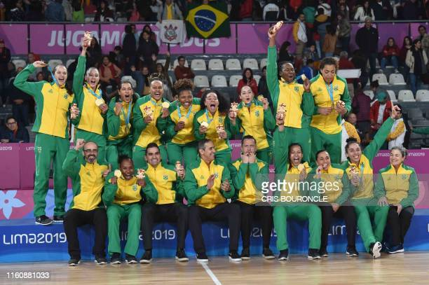 Members of Brazil's team pose with their gold medals on the podium of the Basketball Women's competition at the Lima 2019 Pan-American Games in Lima...