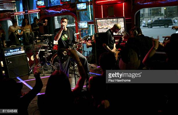Members of Breaking Benjamin appear on FUSE TV's Daily Download show July 21 2004 in New York City
