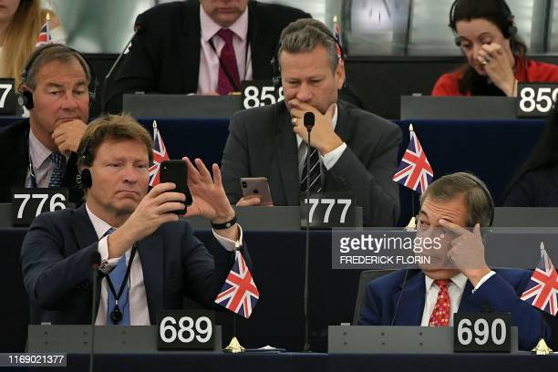 Members of Brexit Party Rupert Lowe Nathan Gill Richard Tice and Nigel Farage attend a debate on Brexit at the European Parliament in Strasbourg...