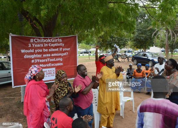 Members of 'BringBackOurGirls' movement stage a demonstration prior to a welcoming ceremony after the releasing 82 of school girls kidnapped by Boko...