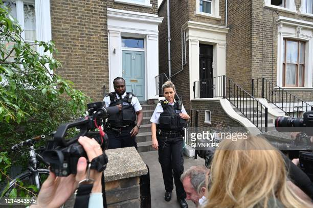 Members of Britain's Metropolitan Police force leave after knocking at the front door of the home of Number 10 Downing Street special advisor Dominic...
