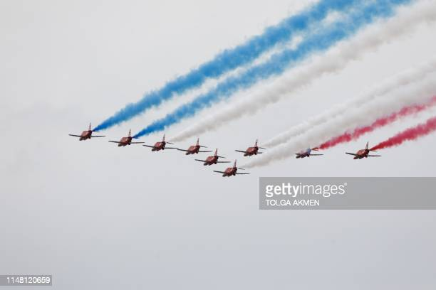 Members of Britain's Red Arrows the flying display team of the Royal Air Force take part in an event to commemorate the 75th anniversary of the DDay...