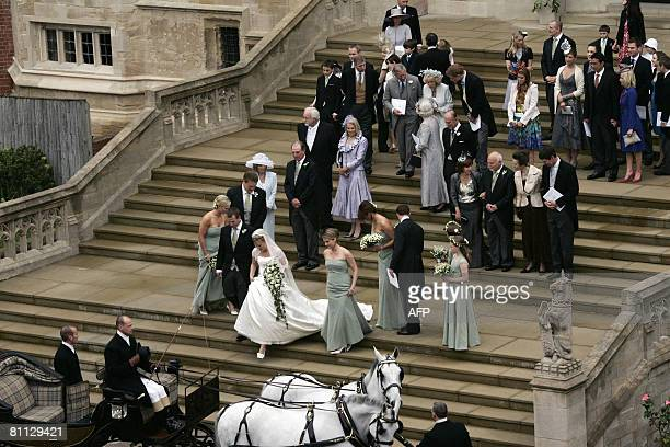 Members of Britains royal family and guests leave St George's Chapel in Windsor on May 17 2008 after the marriage vows of Peter Phillips 30 and...