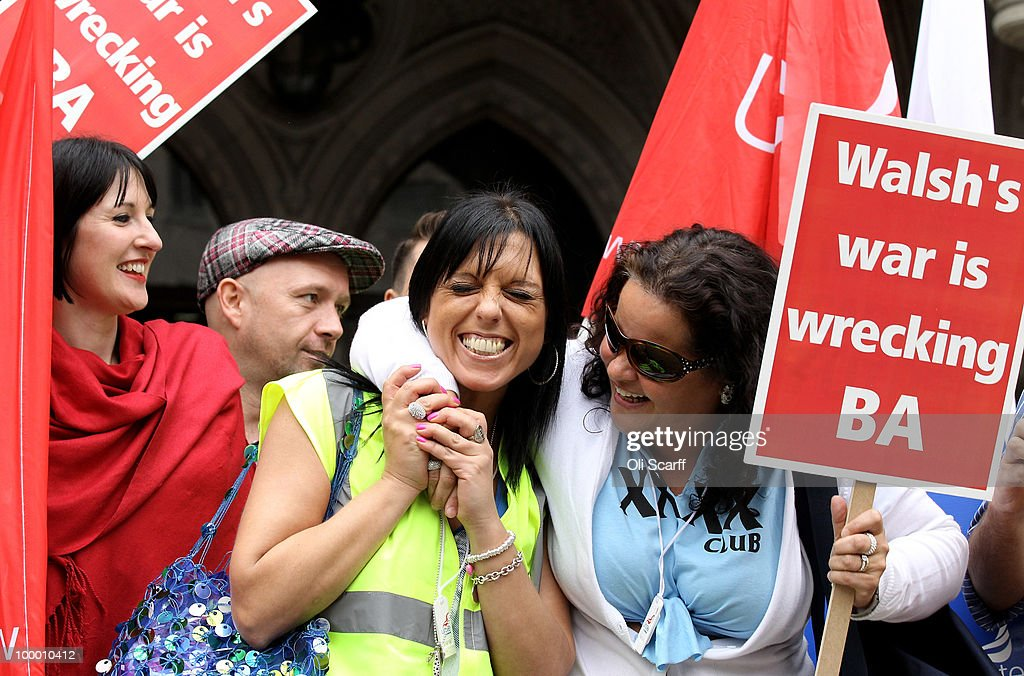 Members of British Airways cabin crew celebrate the High Court's decision to overturn a ban on strike action by BA cabin crew outside the High Court on May 20, 2010 in London, England. The High Court had previously granted British Airways an injunction against industrial action by cabin crew over failings by the Unite union in their reporting of the results of its strike ballot to members.