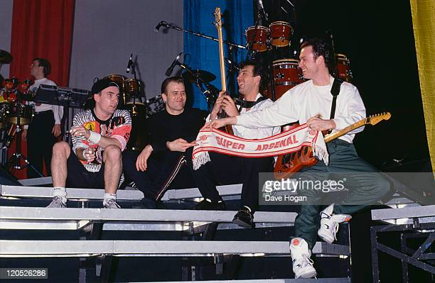 Members of British pop group Spandau Ballet with an Arsenal football scarf at a soundcheck circa 1985 Left to right drummer John Keeble saxophonist...