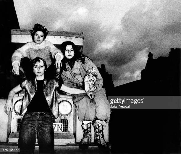 Members of British punk group The Slits posing on a Land Rover in Daventry Street London NW1 1977 Clockwise from top left drummer Palmolive singer...