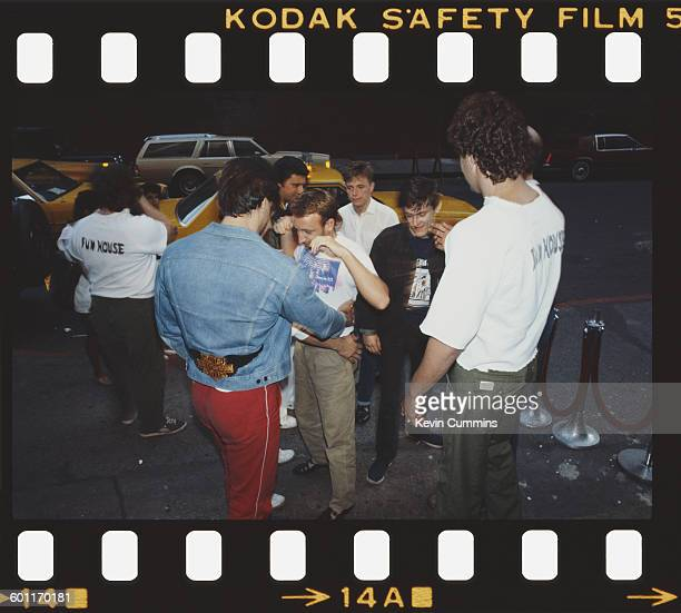 Members of British rock group New Order are checked by security staff New York July 1983 Centre left to right bassist Peter Hook singer/guitarist...