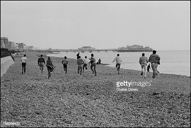 Members of British ska groups The Selecter Madness and The Specials run down Brighton Beach on the first date of the 2 Tone Tour in October 1979