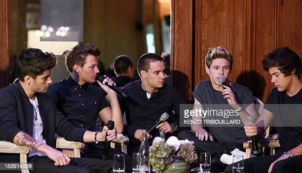 Members of BritishIrish boy band One Direction Zayn Malik Louis Tomlinson Liam Payne Niall Horan and Harry Styles give a press conference on October...