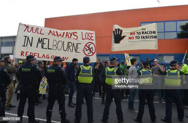 Members of Campaign Against Racism and Fascism hold a banner reading You'll Always Lose In Melbourne including a Nazi sign crossed out during a...
