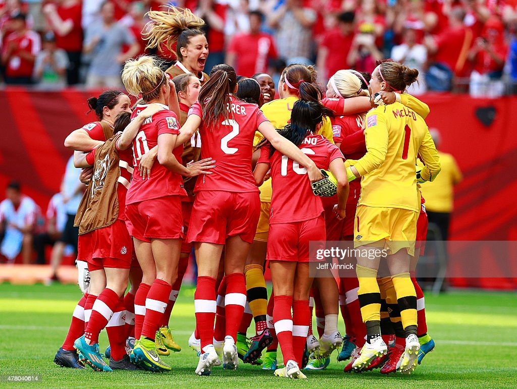Members of Canada celebrate after their win during the FIFA Women's World Cup Canada 2015 Round 16 match between Switzerland and Canada June 21, 2015 at BC Place Stadium in Vancouver, British Columbia, Canada. Canada won 1-0.