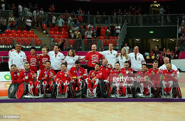 Members of Canada pose with the Silver Medal during the Medal ceremony of Mixed Wheelchair Rugby on day 11 of the London 2012 Paralympic Games at...
