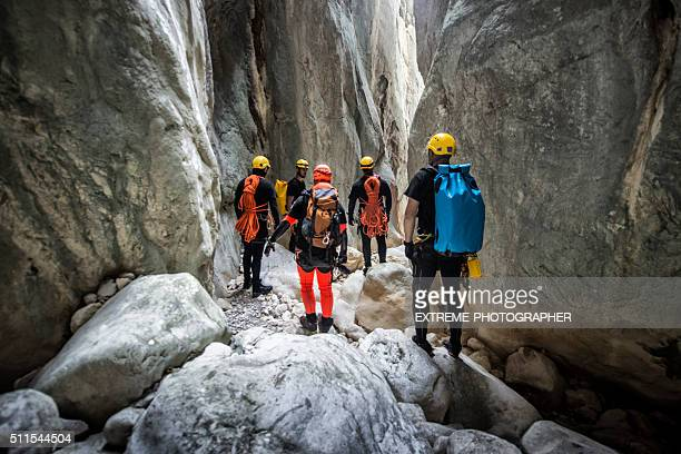Members of canyoning team moving through the canyon