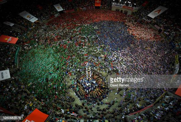 Members of Capgrossos de Mataró build a human tower during the 27th Tarragona Competition on October 07 2018 in Tarragona Spain The 'Castellers' who...