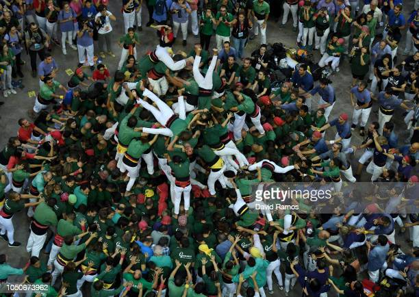 Members of Castellers de Sant Cugat fall down as they build a human tower during the 27th Tarragona Competition on October 07 2018 in Tarragona Spain...