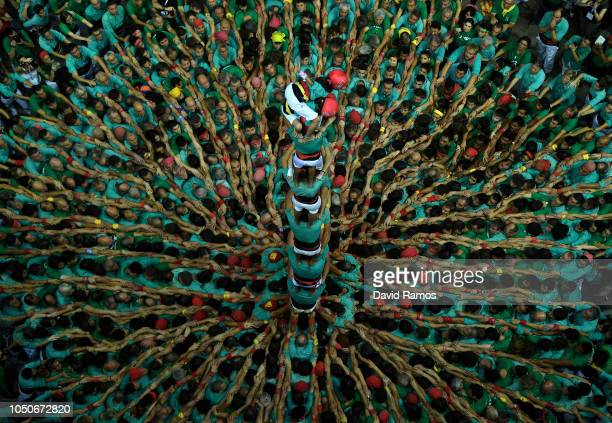 Members of Castellers de Vilafranca build a human tower during the 27th Tarragona Competition on October 07 2018 in Tarragona Spain The 'Castellers'...