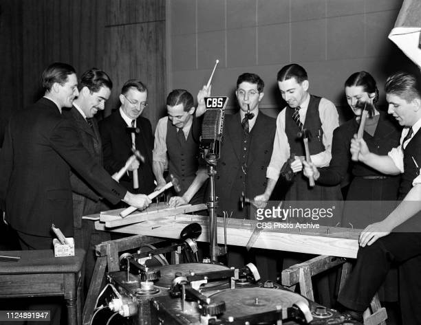Members of CBS Radios' Columbia Workshop sound effects including figures 1 unidentified William N Robson director figure 3 unidentified George...