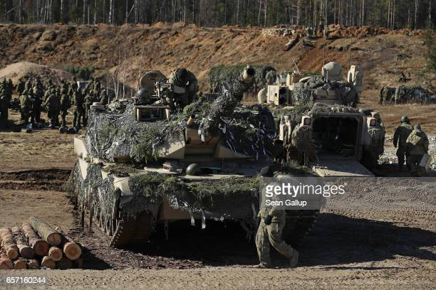 Members of Chaos Company 168 Armor Battalion of the 3rd Brigade Combat Team 4th Infantry Division stand near their M1 Abrams tanks and a M2A3 Bradley...