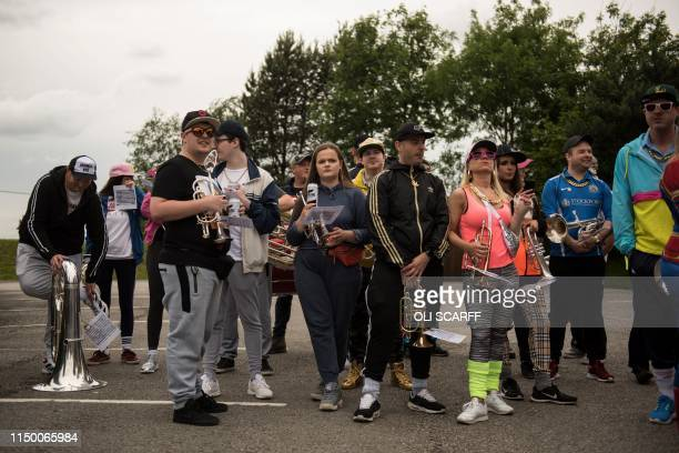 Members of 'Chav Brass' band prepare to play in the Whit Friday brass band competition in the village of Lydgate near Oldham northern England on June...