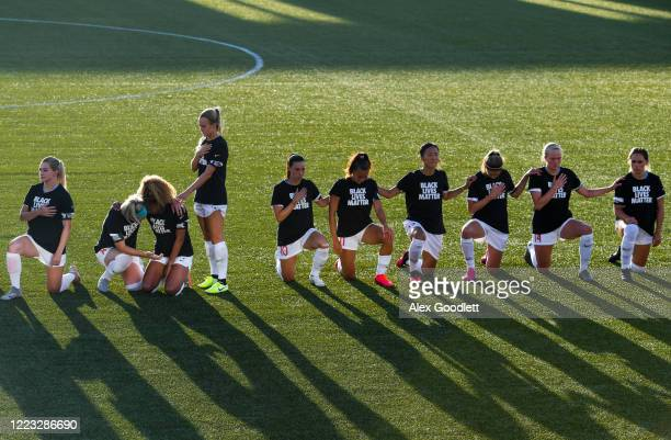 Members of Chicago Red Stars take a knee during national anthem before a game against the Washington Spirit in the first round of the NWSL Challenge...