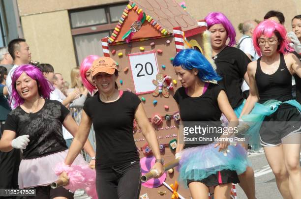 Members of Child Development Centre Candyland run to the finish point during The 2011 Sedan Chair Race Bazaar at Matilda International Hospital in...