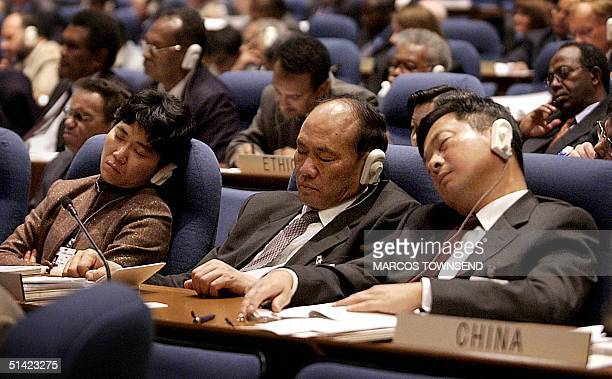 Members of China's delegation at the International Civil Aviation Organization ministers meeting nap during the first of two days of meetings 19...