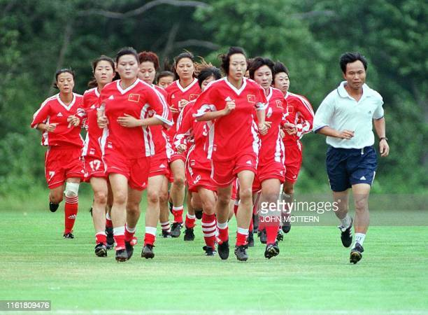 Members of China's Women's World Cup soccer team jog before their parctice at Babson College 02 July 1999 in Wellesley Massachusetts A confident...