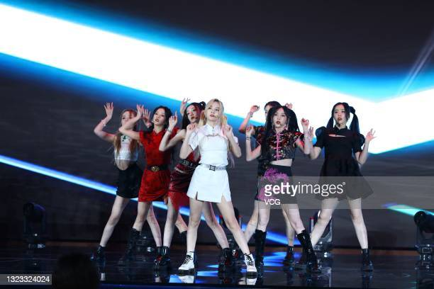 Members of Chinese girl group BonBon Girls 303 perform on the stage during the magazine 'LEON' 12th anniversary event on June 11, 2021 in Shanghai,...