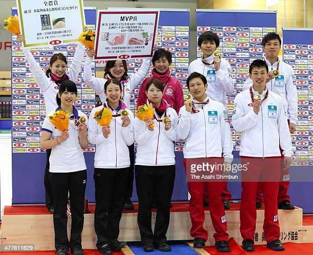 Members of Chubu Electric Power Co and SC Karuizawa celebrate winning the championships after the 31st All Japan Curling Championships at Karuizawa...