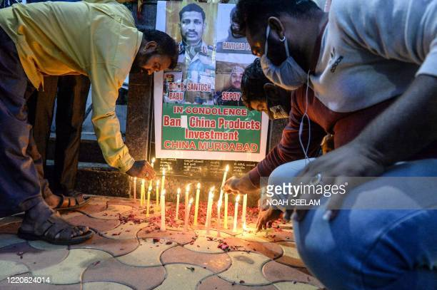 Members of City Youth organisations light candles to pay tribute to the soldiers who lost their lives following a recent clash between India and...