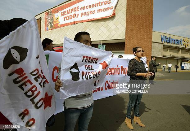 Members of civil associations Red Mexicana contra la Inmunidad de Walmart and Frente del Pueblo hold a protest in front of US giant Walmart...
