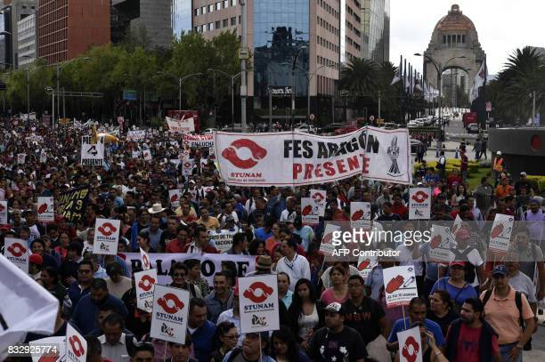 Members of civil organizations peasants and Mexican workers march during a protest against the NAFTA in Mexico City on August 16 2017 Negotiators...