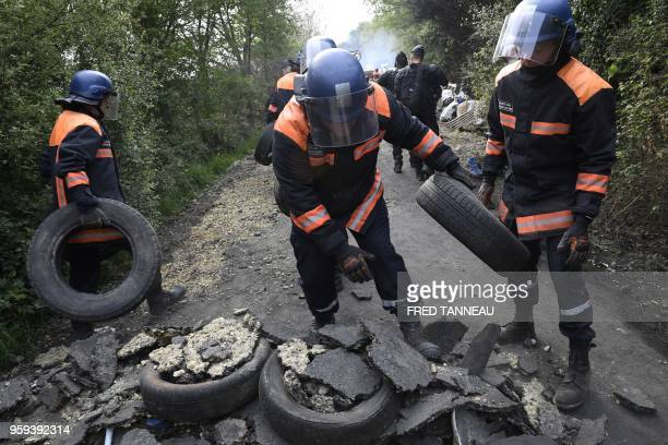 Members of civil security with military training remove a makeshift barricade during a second eviction of environmental protesters from the area...