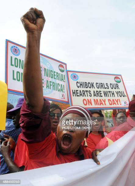 Members of civil society groups hold placards and shout slogans as they protest the abduction of Chibok school girls during a rally pressing for the...