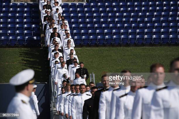 Members of Class of 2018 enter the NavyMarine Corps Memorial Stadium during a graduation ceremony at the US Naval Academy May 25 2018 in Annapolis...