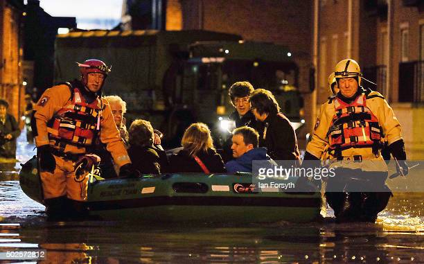 Members of Cleveland Mountain Rescue and soldiers from 2 Battalion The Duke of Lancasters Regiment assist members of the public as they are evacuated...