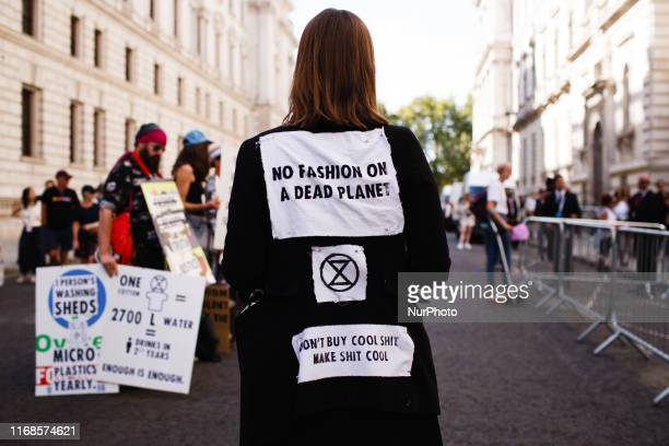 Members of climate change activist group Extinction Rebellion protest against London Fashion Week outside the Foreign and Commonwealth Office an LFW...