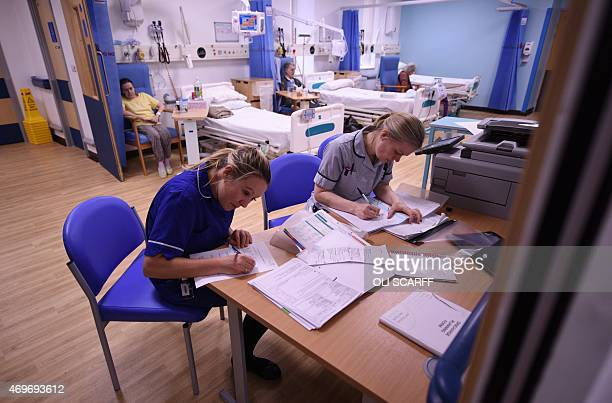 Members of clinical staff complete paperwork in the Accident and Emergency department of the 'Royal Albert Edward Infirmary' in Wigan north west...