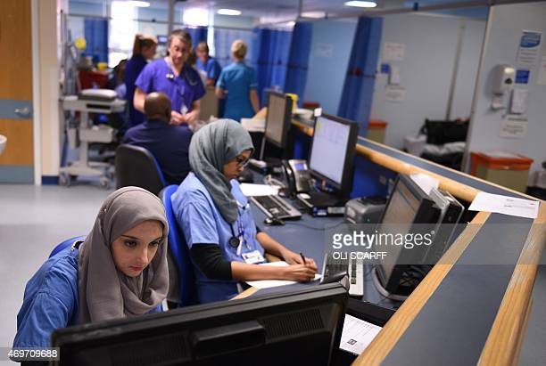 Members of clinical staff work at computers in the Accident and Emergency department of the 'Royal Albert Edward Infirmary' in Wigan north west...