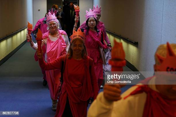 Members of Code Pink for Peace arrive for a hearing of the Senate Judiciary Committee to protest against US Attorney General Jeff Sessions in the...