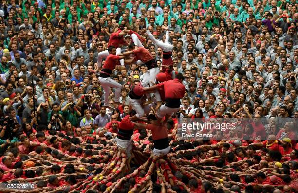 Members of Colla Joves Xiquets de Valls fall down as they built a human tower during the 27th Tarragona Competition on October 07 2018 in Tarragona...