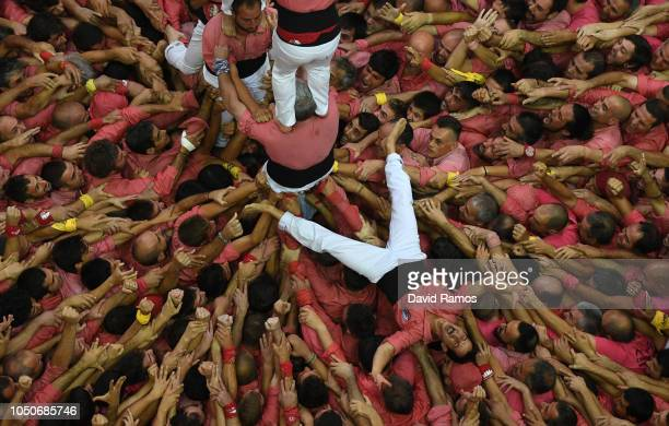 Members of Colla Vella dels Xiquets de Valls celebrate after building a human tower during the 27th Tarragona Competition on October 07 2018 in...