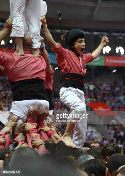 Members of Colla Vella dels Xiquets de Valls celebrate as they built a human tower during the 27th Tarragona Competition on October 07 2018 in...