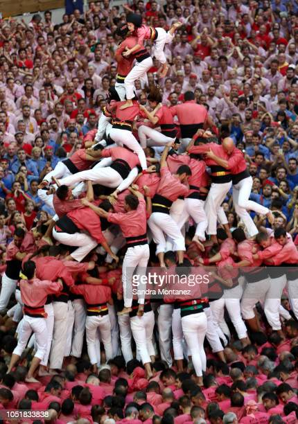 Members of Colla Vella dels Xiquets de Valls fall down as they built a human tower during the 27th Tarragona Competition on October 07 2018 in...