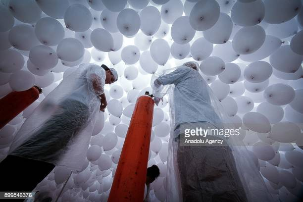 Members of Commercial Association of Sao Paulo prepare thousands of biodegradable balloons to release as they celebrate the arrival of the New Year...
