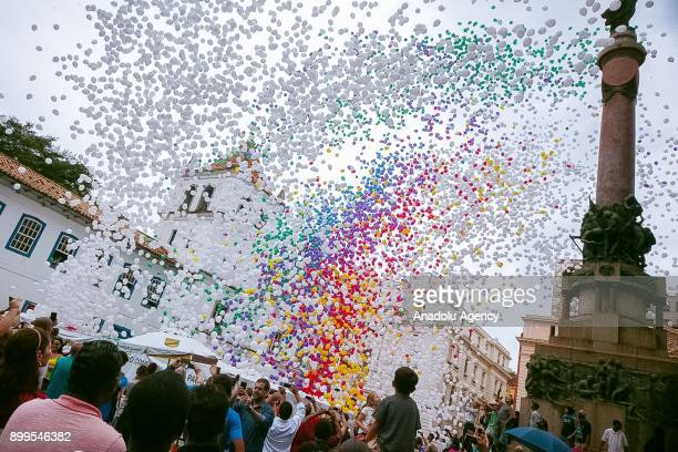 Members of Commercial Association of Sao Paulo release thousands of biodegradable balloons during the arrival of the New Year celebrations at the...