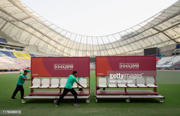 Members of competition staff work on the set up prior to the 17th IAAF World Athletics Championships Doha 2019 at Khalifa International Stadium on...