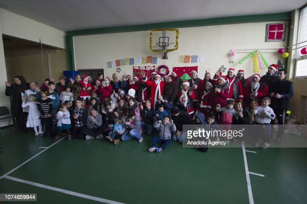 Members of Condor Motorcycle Club wearing Santa Claus clothes pose for a photo with abandoned children after they rode motorcycles around the city to...