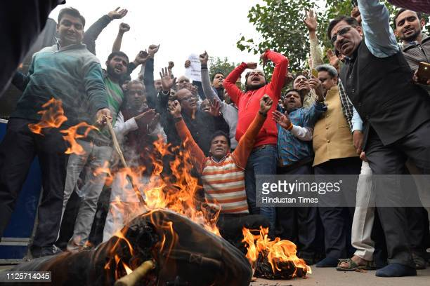 Members of Confederation of All India Traders burn effigy during a nationwide trade bandh today to express solidarity with the families of the CRPF...